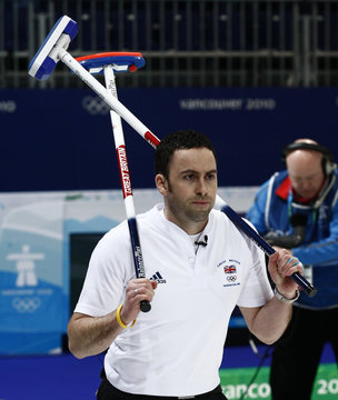 Britain's skip Murdoch leaves after Sweden defeated Britain in their men's tie-breaker curling game at the Vancouver 2010 Winter Olympics