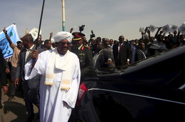 Sudan's President Omar Hassan al-Bashir waves to supporters after returning from the Arab Summit, ahead of the general election in Khartoum