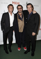 """Actor Sean Penn, director Julian Schnabel, and actor Josh Brolin arrive at the premiere of """"Miral"""" in New York"""