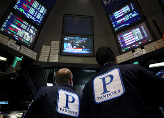 File photo of traders working at the kiosk where Pandora internet radio is traded on the floor of the New York Stock Exchange