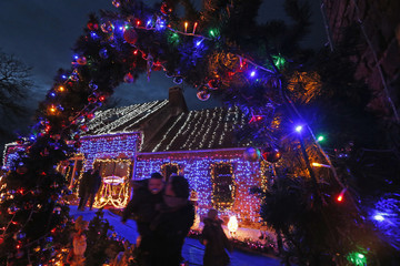 People look at Christmas decorations at the home of Virginie and Jessy in Paillencourt, near Cambrai