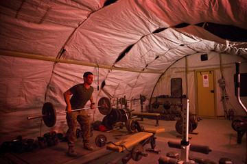 A U.S. Army soldier from 1st Platoon, Alpha Company, 1st Battalion, 36th Infantry works out at Strong Point DeMaiwand, Maywand District, Kandahar province