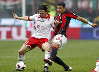 AC Milan's Thiago Silva fights for the ball with Bari's Rudolf during their Italian Serie A soccer match in Milan.
