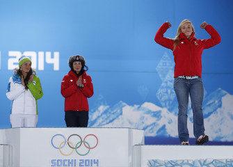 Bronze medalist Switzerland's Gut celebrates next to joint gold medalists Switzerland's Gisin and Slovenia's Maze during the medal ceremony for the women's alpine skiing downhill race at the Sochi 2014 Winter Olympic Games in Sochi