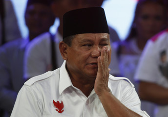 Indonesian presidential candidate Prabowo Subianto reacts during a TV appearance in Jakarta