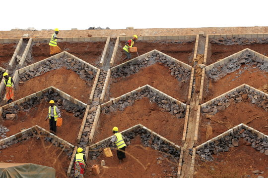 Construction labourers work at a landscaping section of the Mombasa-Nairobi standard gauge railway near Emali in Kenya