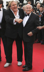 """Actor Gerard Depardieu and FIFA President Sepp Blatter pose on the red carpet for the screening of the film """"United Passions"""" at the 67th Cannes Film Festival in Cannes"""