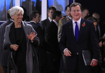 International Monetary Fund President Christine Lagarde and Britain's Prime Minister David Cameron arrive for the start of the G20Summit of major world economies in Cannes