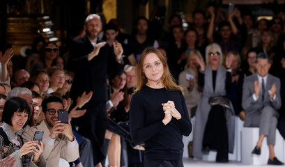 British designer Stella McCartney appears at the end of her Spring/Summer 2017 women's ready-to-wear collection during Fashion Week in Paris