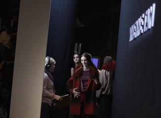 Models prepare to step onto the runway before the Vivienne Tam Fall/Winter 2012 collection show during New York Fashion Week