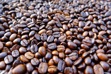 Coffee beans background. roasted coffee beans, can be used as a background. Close up and Macro.