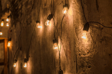 Electric light bulbs on grunge background
