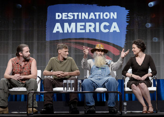 "Cast members sit with executive producer Sarah Helman during a panel discussion of the ""Hillbilly Blood"" reality series during the Discovery Communications portion of the 2014 Television Critics Association Cable Summer Press Tour in Beverly Hills"