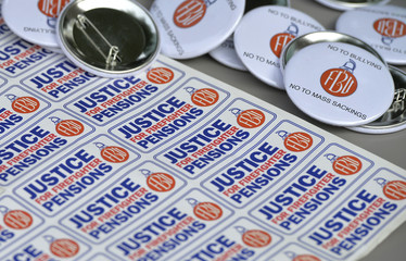 Stickers and badges lay on a table on a picket line during a strike at Euston fire station in London