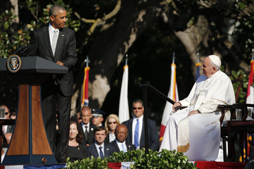 U.S. President Barack Obama looks back at Pope Francis as he delivers remarks upon the pontiff's arrival at the White House in Washington