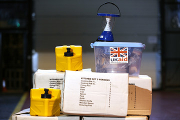 Items from a kitchen set  seen at a UK aid Disaster Response Centre, where cases of them are stored, at Kemble Airport, southern England