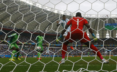 Argentina's Marcos Rojo scores a goal during their 2014 World Cup Group F soccer match against Nigeria at the Beira Rio stadium in Porto Alegre