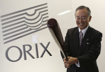 Orix Corp Chairman and Chief Executive Officer Miyauchi holding a baseball bat poses for a photo during an interview with Reuters in Tokyo