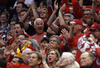 New Mexico fans react to a play against Harvard during the second half of their second round NCAA tournament basketball game in Salt Lake City, Utah