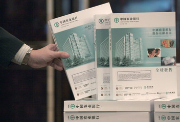 Prospectuses for Agricultural Bank of China's Hong Kong IPO are displayed at a news conference in Hong Kong