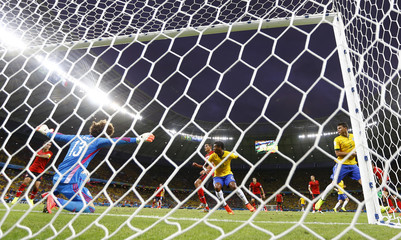 Mexico's Ochoa makes a save against Brazil during their 2014 World Cup Group A soccer match at the Castelao arena in Fortaleza