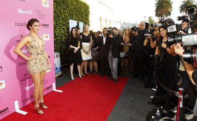Actress Reed poses as she arrives at the Young Hollywood Awards at the Wilshire Ebell theatre in Los Angeles