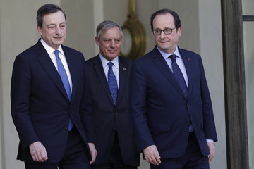 French President Hollande accompanies Bank of France Governor Noyer and European Central Bank (ECB) President Draghi after a lunch at the Elysee Palace in Paris