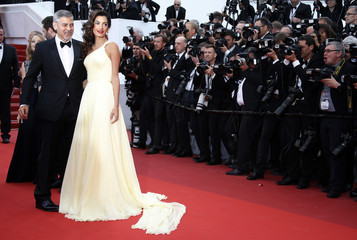 "Cast member George Clooney and his wife Amal  arrive for the screening of the film ""Money Monster"" out of competition during the 69th Cannes Film Festival in Cannes"