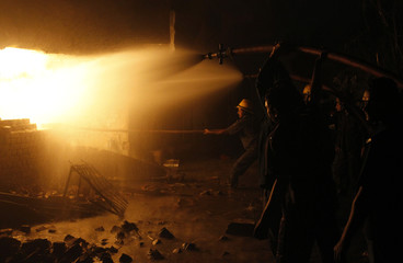 Firefighters try to extinguish a fire inside a solvent processing unit at Vatva industrial area in Ahmedabad