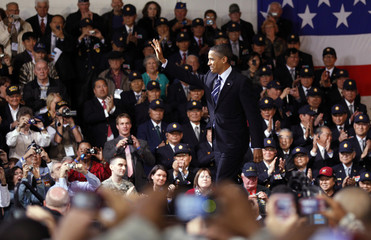 U.S. President Obama walks past South Korean and U.S. veterans at a Veterans Day event at the U.S. Army Garrison at Yongsan military base in Seoul