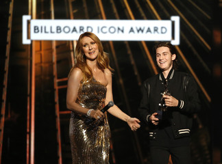 Billboard Icon Award recipient Celine Dion reacts as her son Rene Charles presents the award to her at the 2016 Billboard Awards in Las Vegas