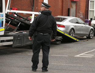 Police remove a vehicle as part of search of premises on Prescot Road after arresting a man on suspicion of preparing acts of terrorism, in Liverpool, north west England
