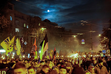 """Members of the Ukrainian national guard """"Azov"""" regiment, activists of the Azov civil corp and the far-right radical group Right Sector take part in a rally to mark Defender of Ukraine Day, in Kiev"""