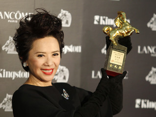 Actress Deanie Ip celebrates winning the Best Leading Actress category at the 48th Golden Horse Film Awards in Hsinchu