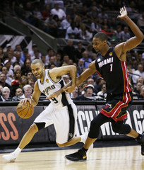 Spurs Parker drives to the net on Heat's Bosh during Game 4 of their NBA Finals basketball series in San Antonio