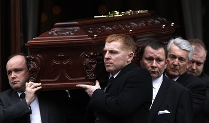 Celtic football club manager Neil Lennon helps carry the coffin of his friend Paul McBride after a requiem mass in Glasgow, Scotland