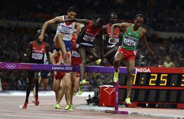 France's Mahiedine Mekhissi-Benabbad, Kenya's Ezekiel Kemboi and Ethiopia's Roba Gari compete in the men's 3000m steeplechase final during the London 2012 Olympic Games at the Olympic Stadium