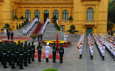US president Brack Obama and his Vietnamese counterpart Tran Dai Quang listen to their countries' anthems during a welcoming ceremony held at the presidential palace in Hanoi