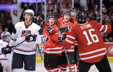 Canada's Schwartz and his teammates Scheifele, Hamilton and Stone celebrate Schwartz's goal as Team USA's Clendening skates away during the first period of play at the 2012 IIHF U20 World Junior Hockey Championships in Edmonton