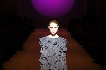 A model presents a creation by Ukrainian designers Kamenskaya and Kononova during Ukrainian Fashion Week in Kiev