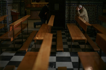 A man prays at Santo Angel's church in the Andalusian capital of Seville