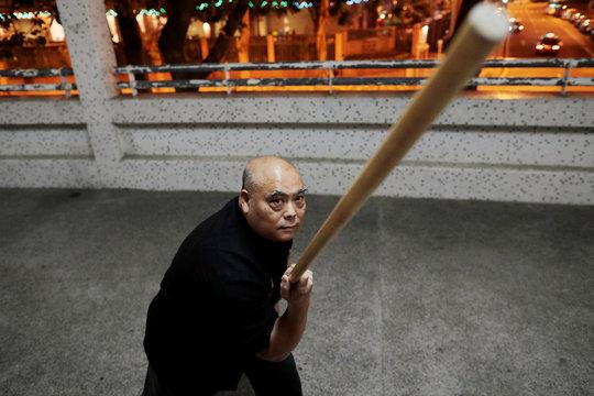 Dragon Sign Kung Fu master Wong Yiu-kau poses at his martial arts class in Hong Kong