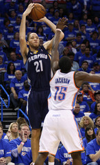 Memphis Grizzlies forward Prince shoots against Oklahoma City Thunder guard Jackson in the second half of their Game 1 NBA Western Conference semi-final playoff basketball game in Oklahoma City
