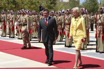 Jordan's King Abdullah and Australian Governor-General Quentin Bryce review a Bedouin honour guard in Amman