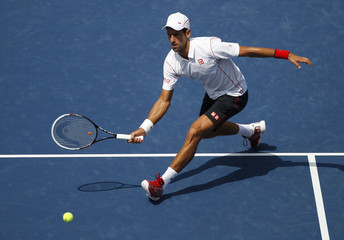 Djokovic of Serbia hits a return to Becker of Germany at the U.S. Open tennis championships in New York