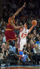 New York Knicks Jeremy Lin lobs shot over Cleveland Cavaliers Tristan Thompson to score in NBA game in New York