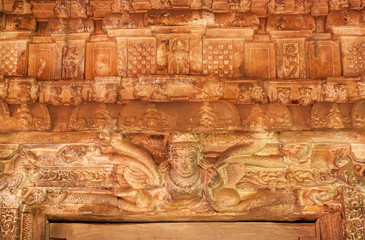 Patterns and figurs of myth creations inside the 7th century Durga temple, medieval era Hindu temple in Aihole, India. Ancient Indian artwork.