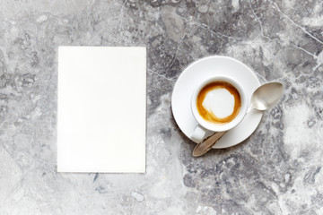 Cup of Espresso Macchiato and a blank Paper Sheet
