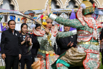 Thailand's Prime Minister Prayuth Chano-cha (L) attends the Children's Day celebration at Government House in Bangkok