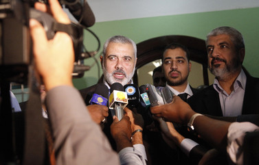 Hamas' Gaza leader Haniyeh speaks to the media with Hamas leader Khald Meshaal after meeting Sudan's President al-Bashir in Khartoum